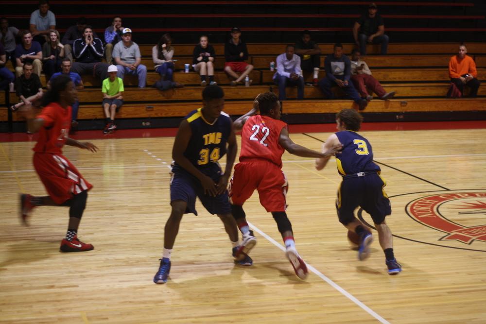 #22 Ashland Royerfollows an opposingplayer down the court.