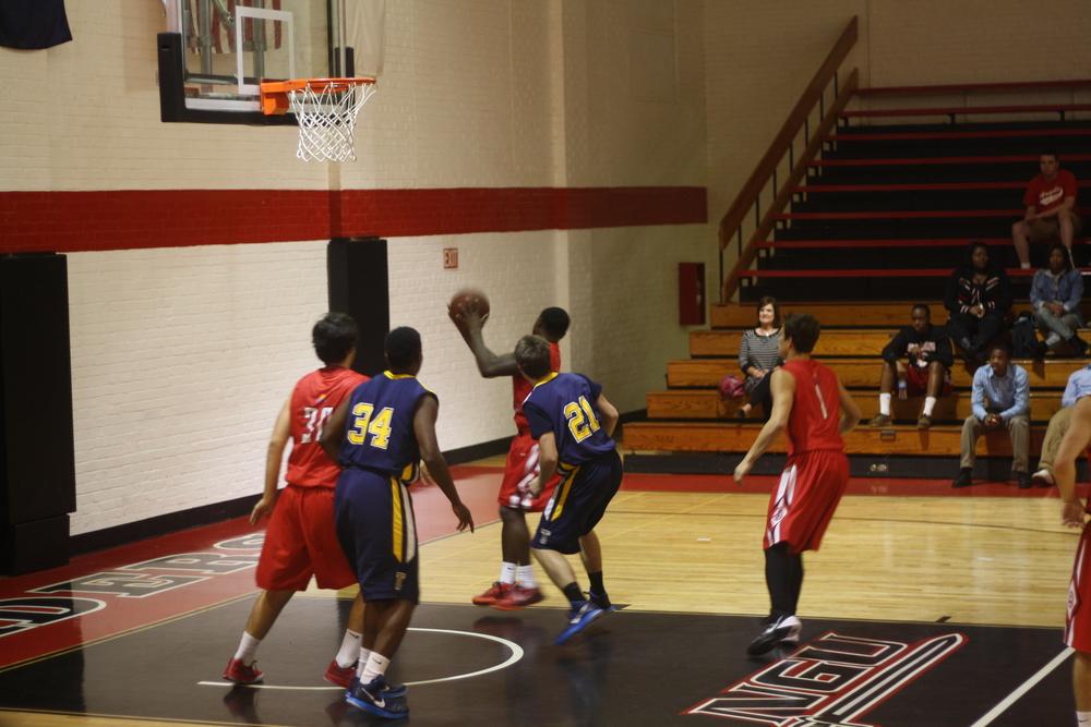 NGU players successfully retrieve the ball.