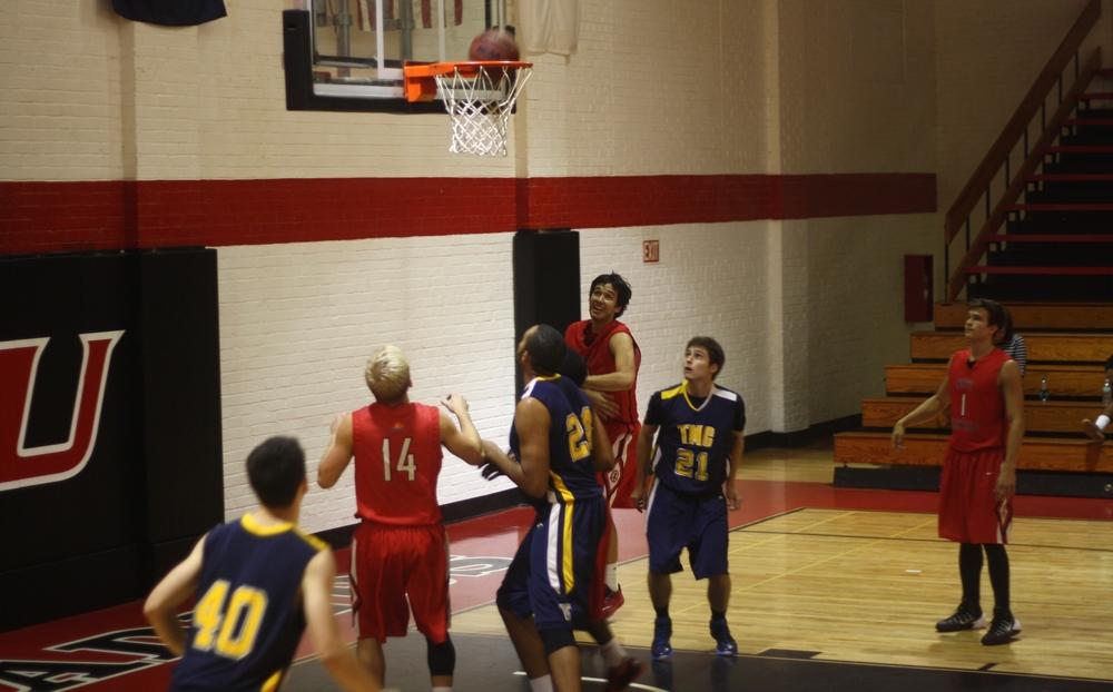 NGU players sink the ball.
