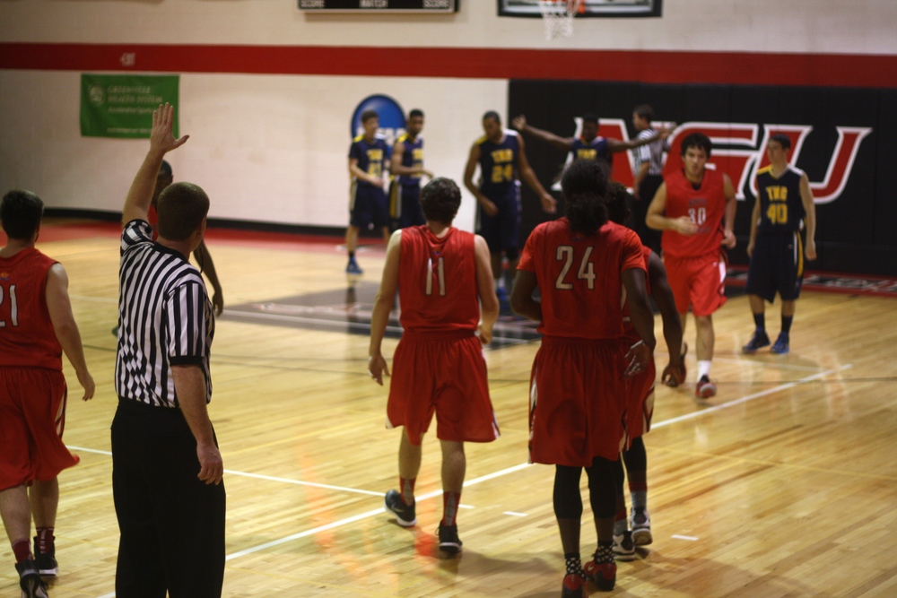 NGU players take their turn on the court.