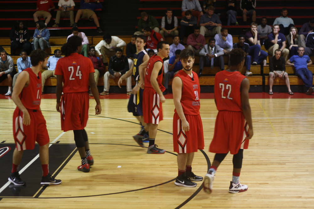 NGU players take their places on the court.