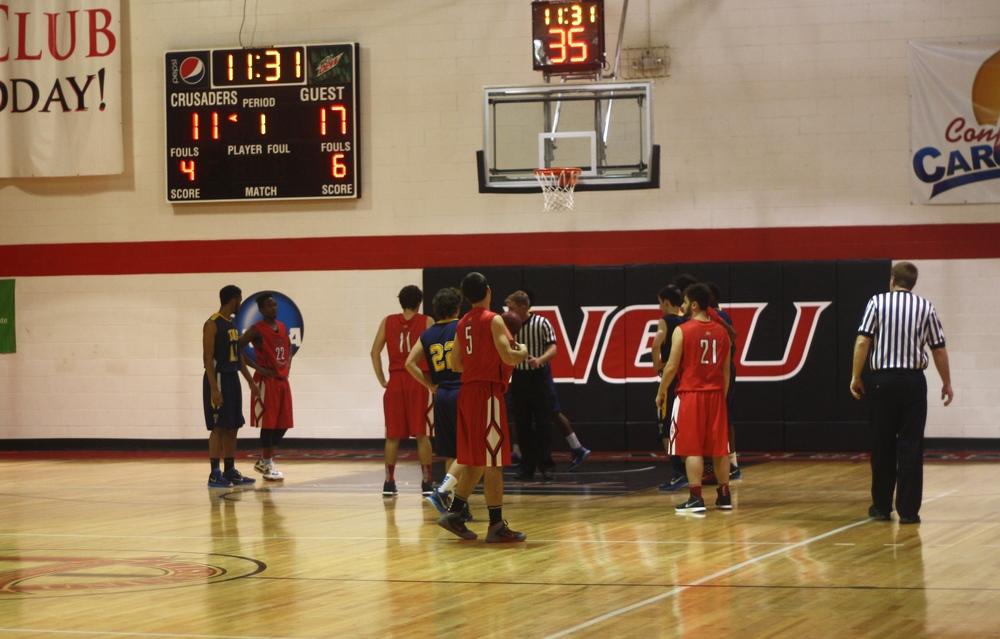 NGU players prepare fora free throw.