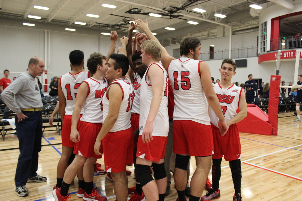 North Greenville Men's Volleyball team gathers around before the start of a match. Photo by Andrew Stevens