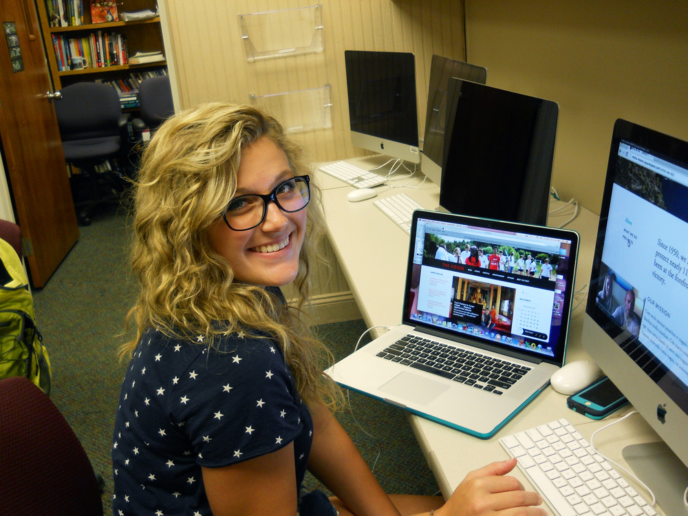 "Carli Frady works on a story for ""The Vision Magazine."""