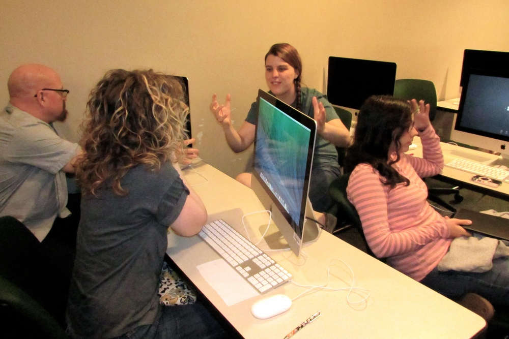 "Students who write for ""The Vision Online"" discuss upcoming stories during a weekly meeting."