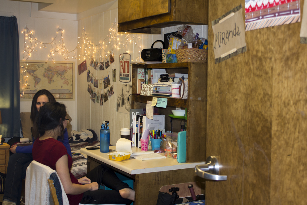 RA's are in charge of staying inside their dorms for an allotted amount of time to monitor. Sophomore Alisa Sandlin sits back and chats with junior Rachel Alley who came to visit her while she was on duty.