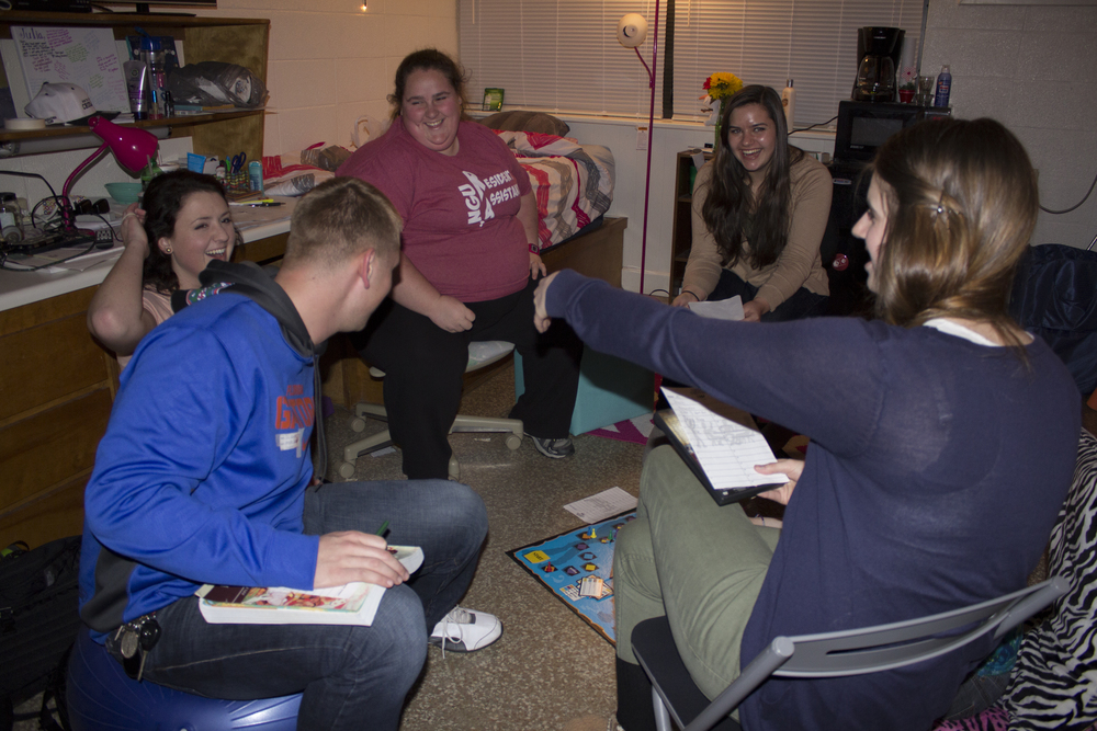NGU students enjoy using open dorms as a chance to gather together to play some board games, laugh and just chat with each other in a different location than simply around campus at places such as the stud. Sophomore Sarah Garrett invited a lot of her friends to come over to play a board game in her room.