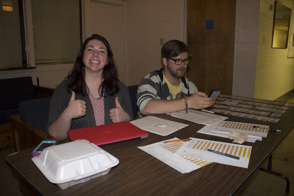 SophomoreAbigail Tinker and Senior Dusty Kennon run one of the check in booths for open dorms during open dorms.