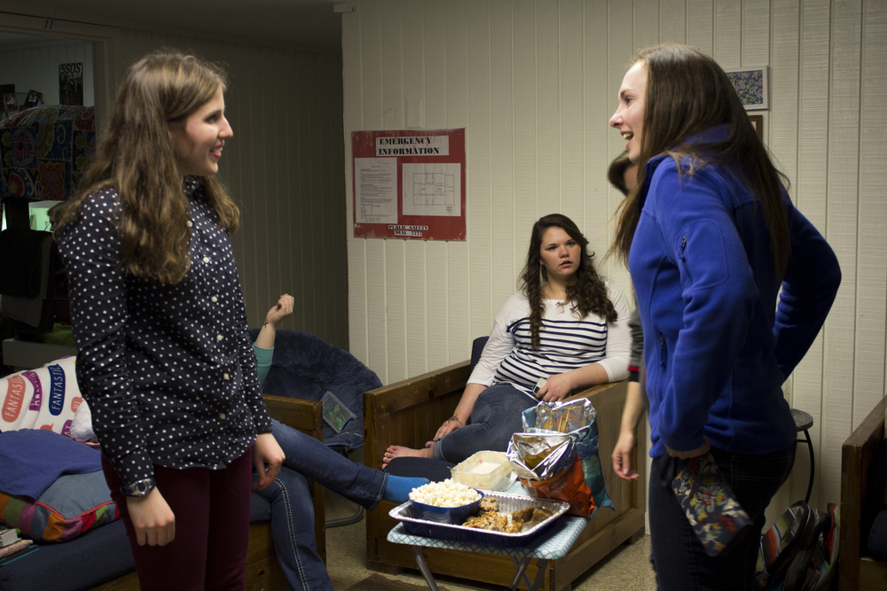 Often during open dorms, girls enjoy preparing food to eat, always making the party that much more fun. Sophomore Meg Darby chats with junior Rachel Alley around the chips and sweets table in the middle of the common room.