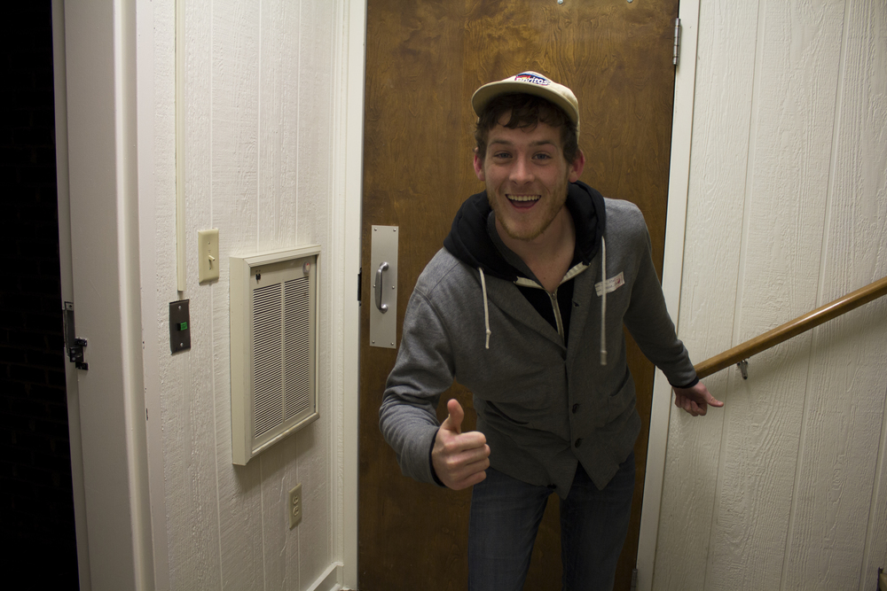 Junior Tyler Ezsol gives his thumbs up approval on the open dorm evening on his way to visit some friends down the hall.