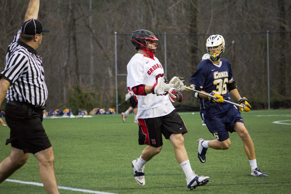Sophomore Drew Wassenaar pushes down the right wing to get into shooting range.