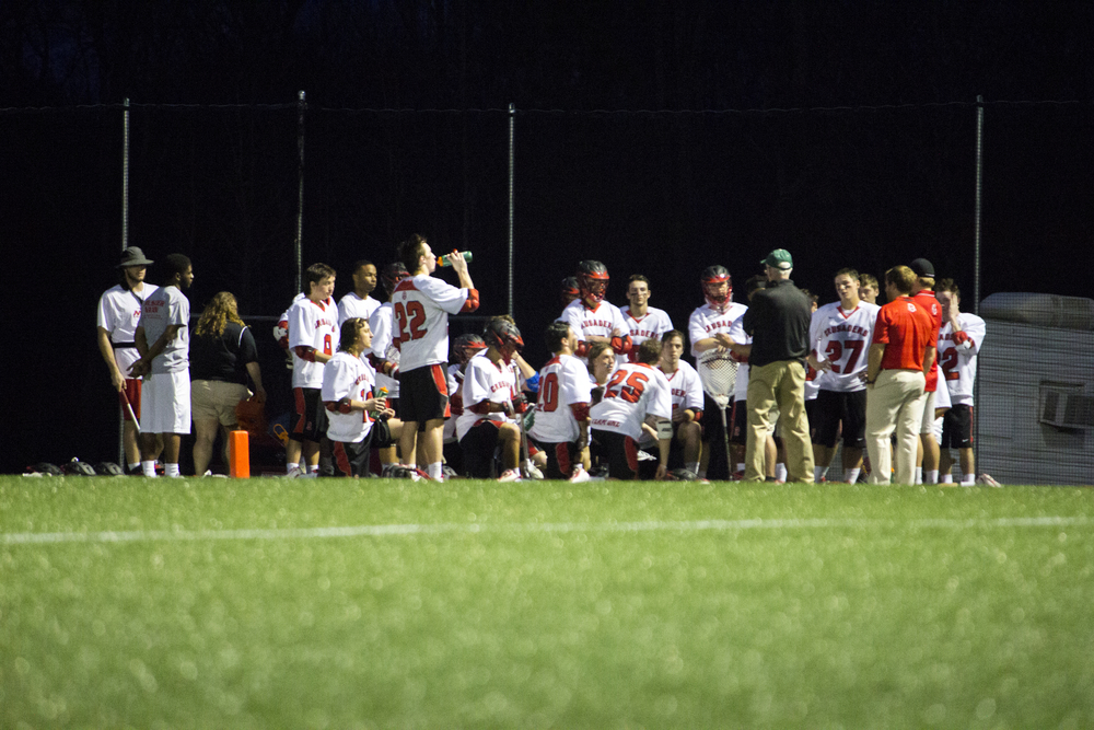 The team gathers up to get encouragement and feedback on the game from their coaches.