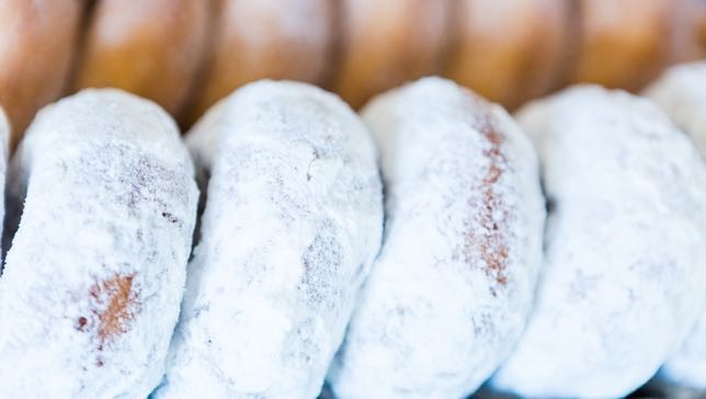 Dunkin' Donuts is working on implementing a new formula for their powdered donuts that does not include titanium dioxide. Photo by:Arina P. Habich  /Shutterstock).