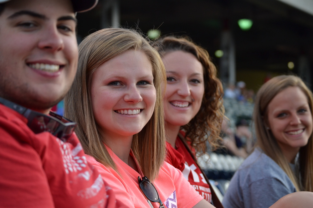 Dillon Webster, Danielle Kiessling, Tori Freedman and Sarah Armstrong cheer on the NGU baseball team with loud screams and excited faces.