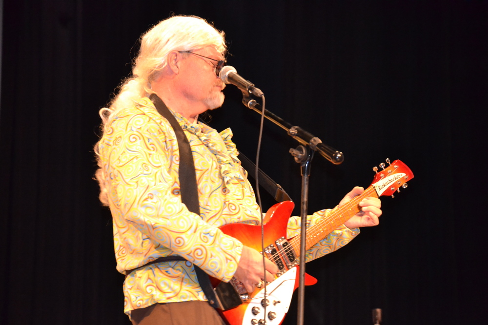 Tony Beam, along with three other faculty, took the stage and sang popular songs for the audience's enjoyment.