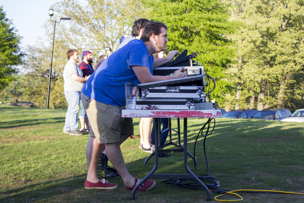 The sound guys on the Media Team do one last check to make sure the event will run smoothly.