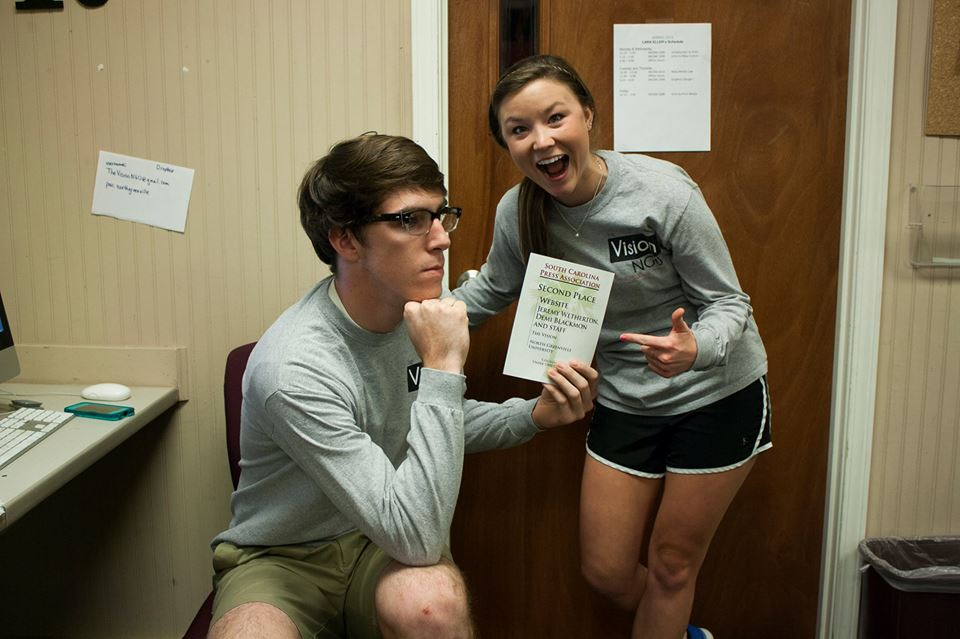 Photo Courtesy of Abigail Tinker.  Editor-in-Chief Jeremy Wetherton and Managing Editor Demi Blackmon celebrate the award they accepted on behalf of The Vision website.