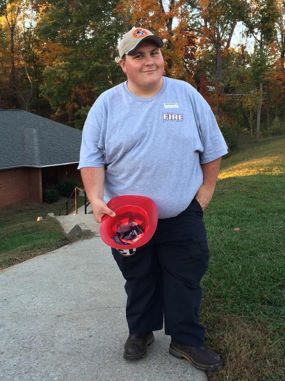 Conley Trammell handed out candy to trick-or-treaters.