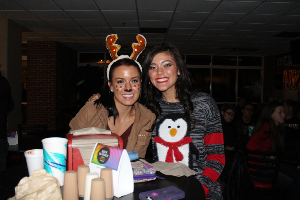 Emily Hambrick and Christal Potter soaking up the music and Christmas cheer.