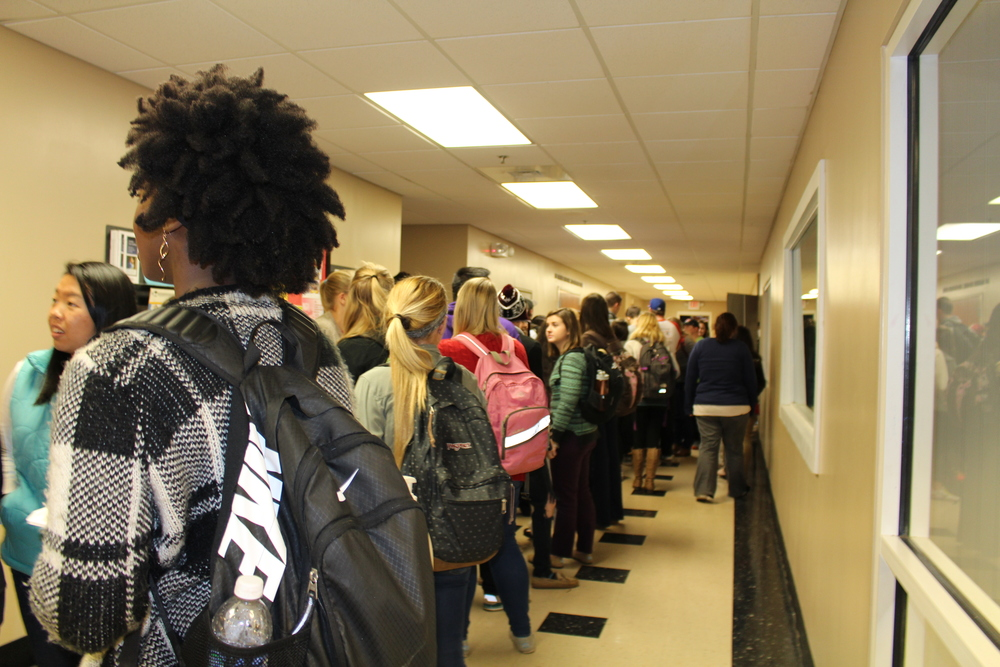 Students wait anxiously for the puppies on campus.
