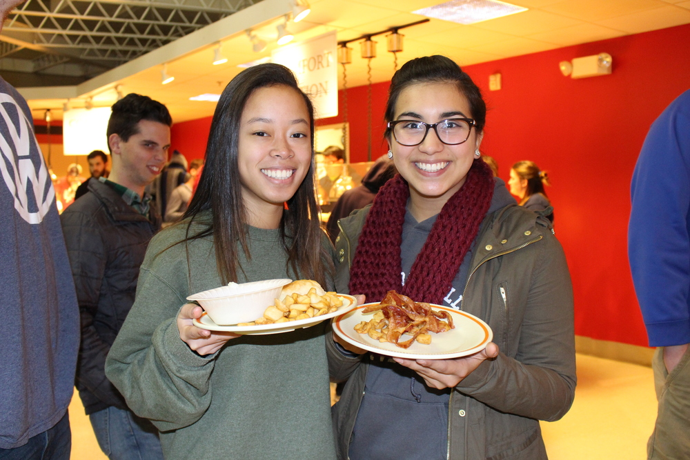 Allie Toy and Ashley Valencia waiting in line for pancakes on Thursday.