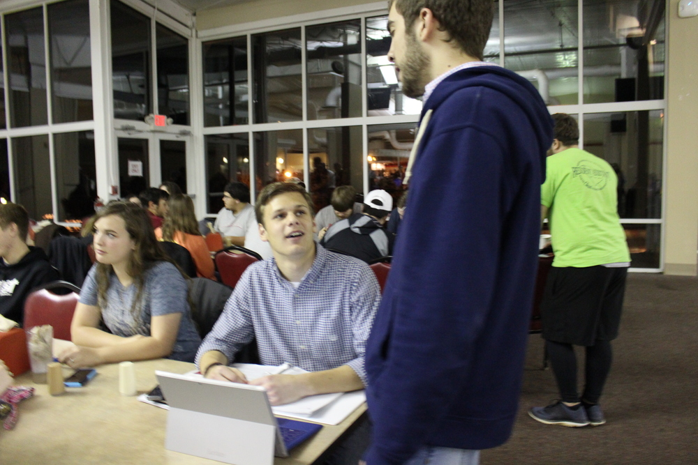 Derek Gahman and Josiah Wright studying and chatting in preparation for finals.