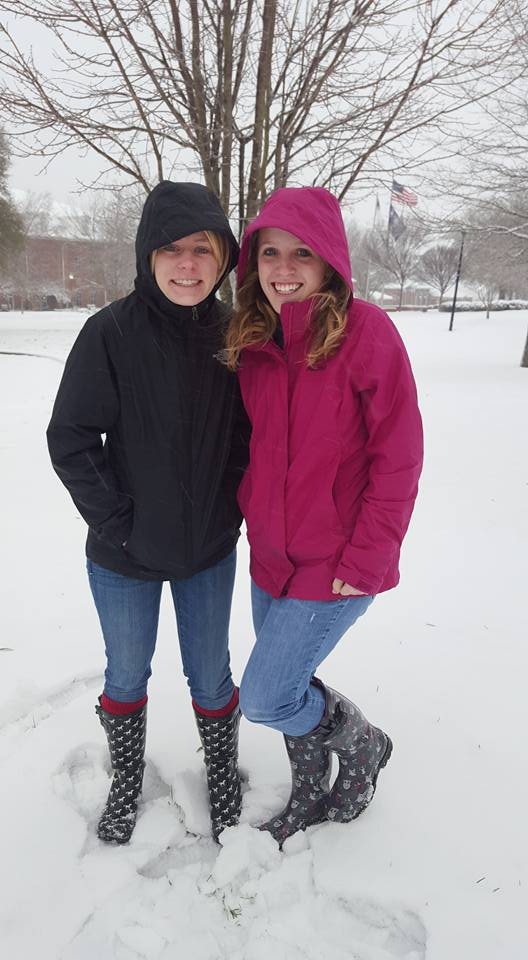 Bailey Stewart and Jessie Prescott explore the fresh snow on Friday.  Photo by: Megan Conley