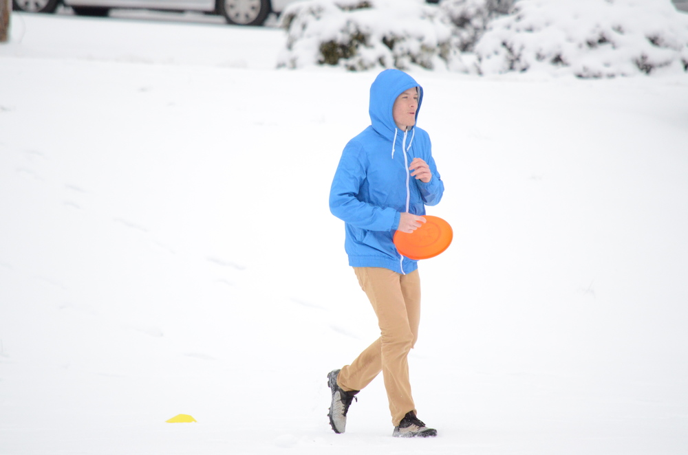 Is Tyler Ezsol really playing Frisbee in this freezing weather?  Photo by: Rebecca Meek