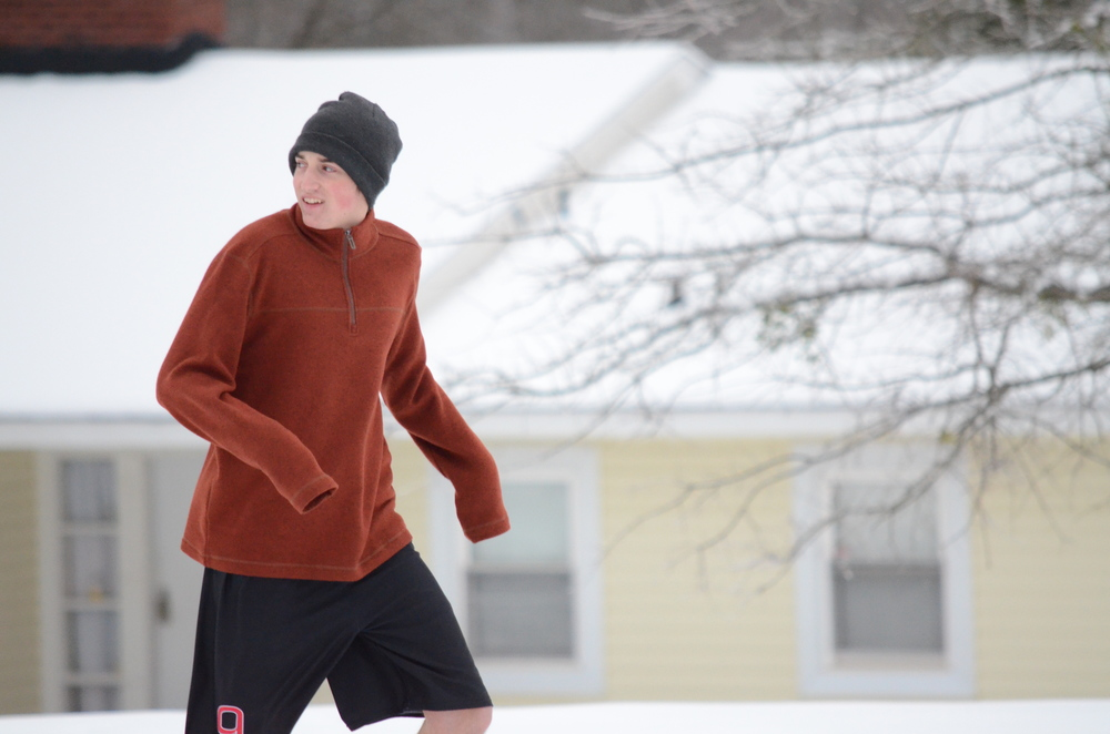 ryan Langston, what are you thinking wearing shorts in the snow?  Photo by: Rebecca Meek