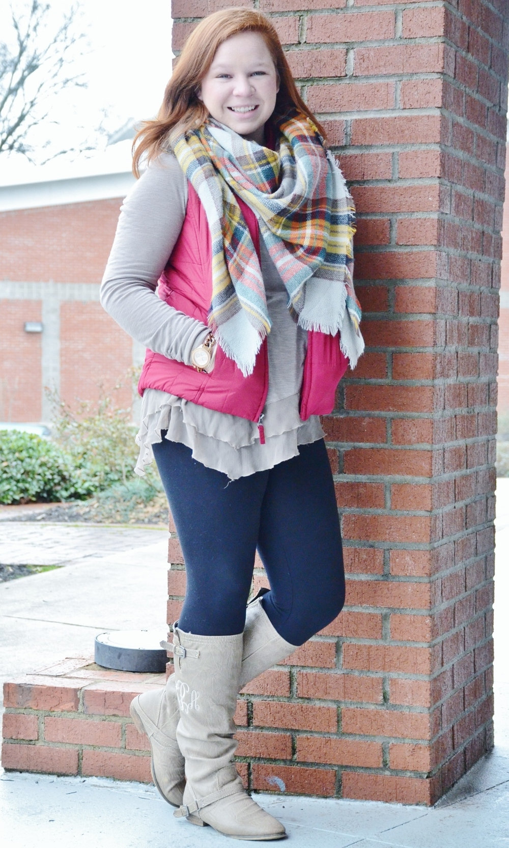 Carson Parnell knows just what to wear when it comes to staying warm. At first glance, it's hard to not notice the multi-colored blanket scarf from Girly Girl Boutique that matches her monogrammed winter boots from Almost Pink. And to put the look altogether, her long-sleeved shirt comes from Cato's.