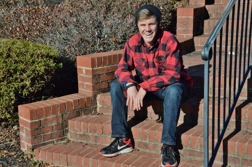 Jehu Jackson sports his casual winter outfit including blue jeans a red flannel long-sleeved shirt. Jackson said he bought his shoes from the Nike Store and most of his outfit he borrowed from his brother. Who doesn't love free stylish clothes?