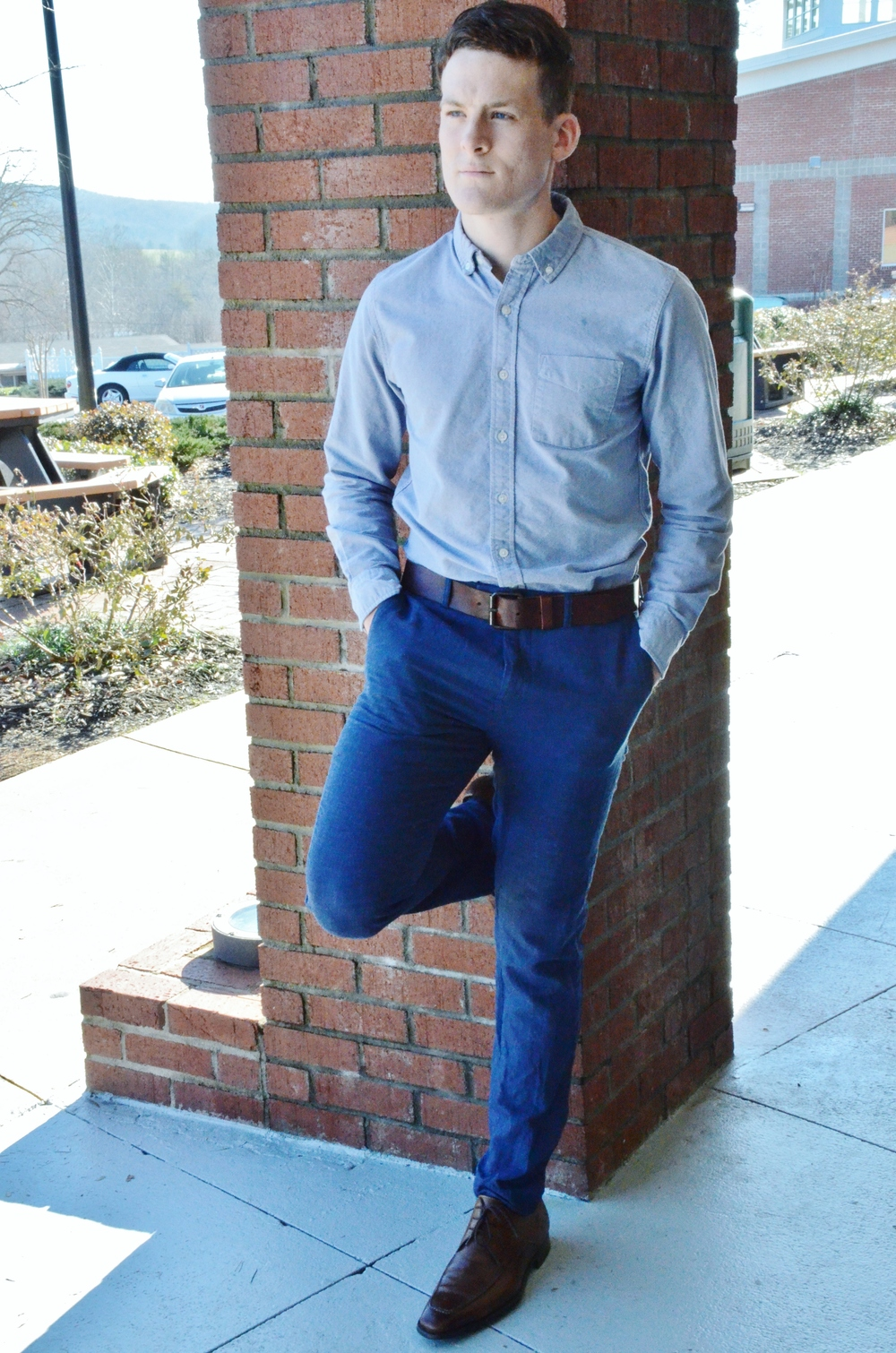 Tyler Ezsol can always be seen as fashionable walking around campus. He is wearing nice blue trousers from H&M along with a matching button down, long sleeved shirt.