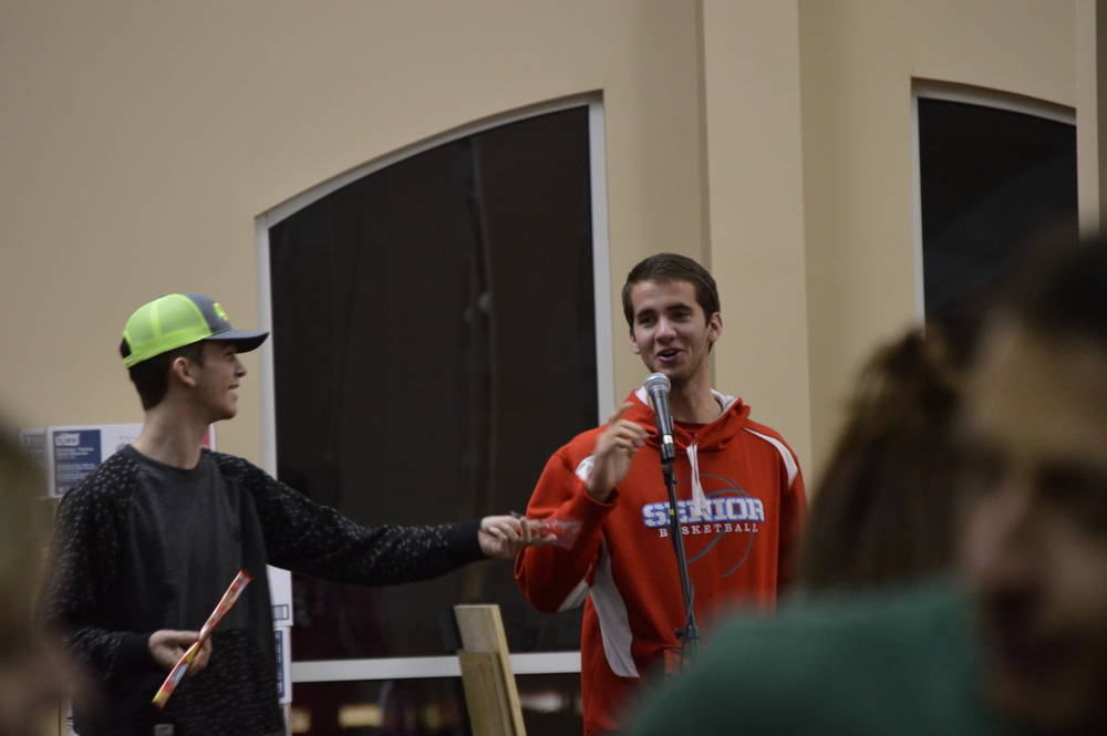 Andrew Guy and Israel Reeves ask Valentine's trivia and give prizes to the winners.