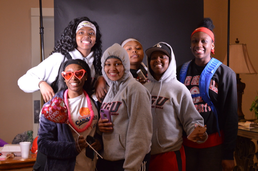 NGU Women's Basketball members, Diovanni Powell, Ty Broadwater, Chantel Strahorn, Cameron Carter, Courtney Williams and assistant Kourtney Hailey have fun at the Instagram Photo Booth.