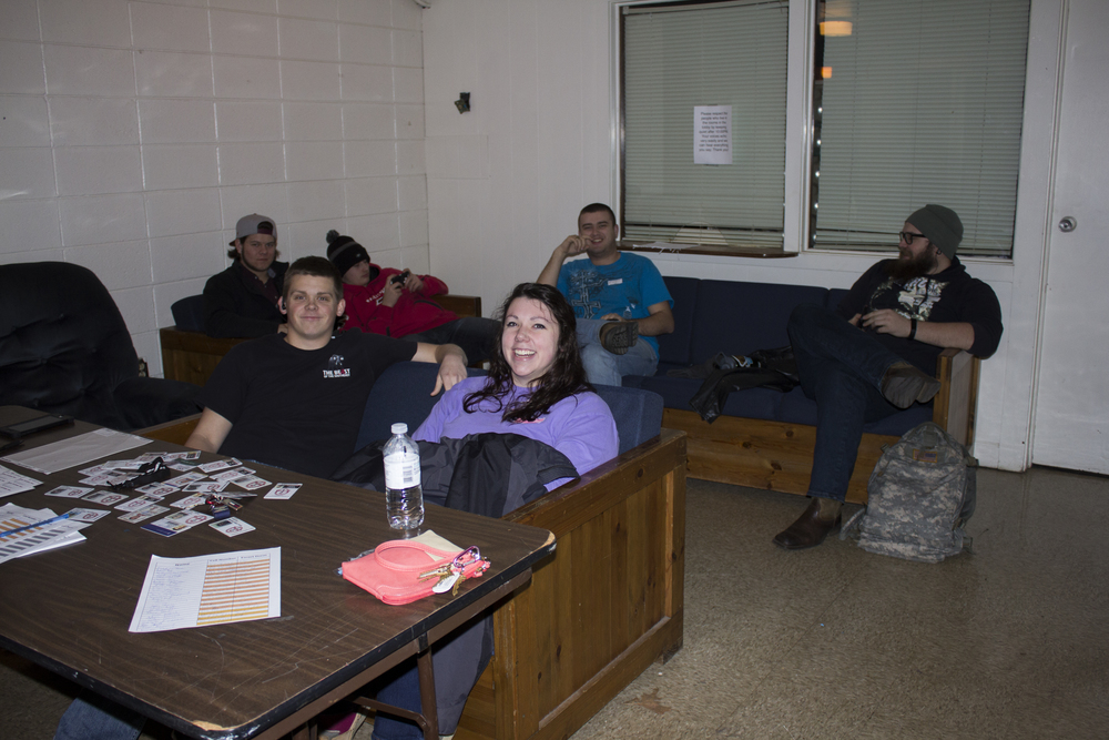 Abigail Tinker, Will Armstrong, Kyle Tatum work alongside their fellow RA's and RC's for open dorm night check-ins.