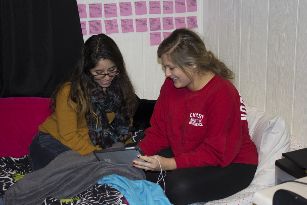 Suit mates Sophia Colmenares and Rachael Cooper enjoy the open dorm night by relaxing in the room.