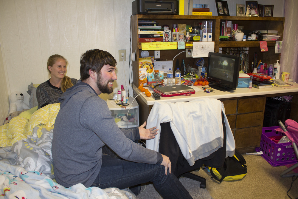 Garret King and McKenzie Botts settle down for a night of TV shows such as the Amazing Race.