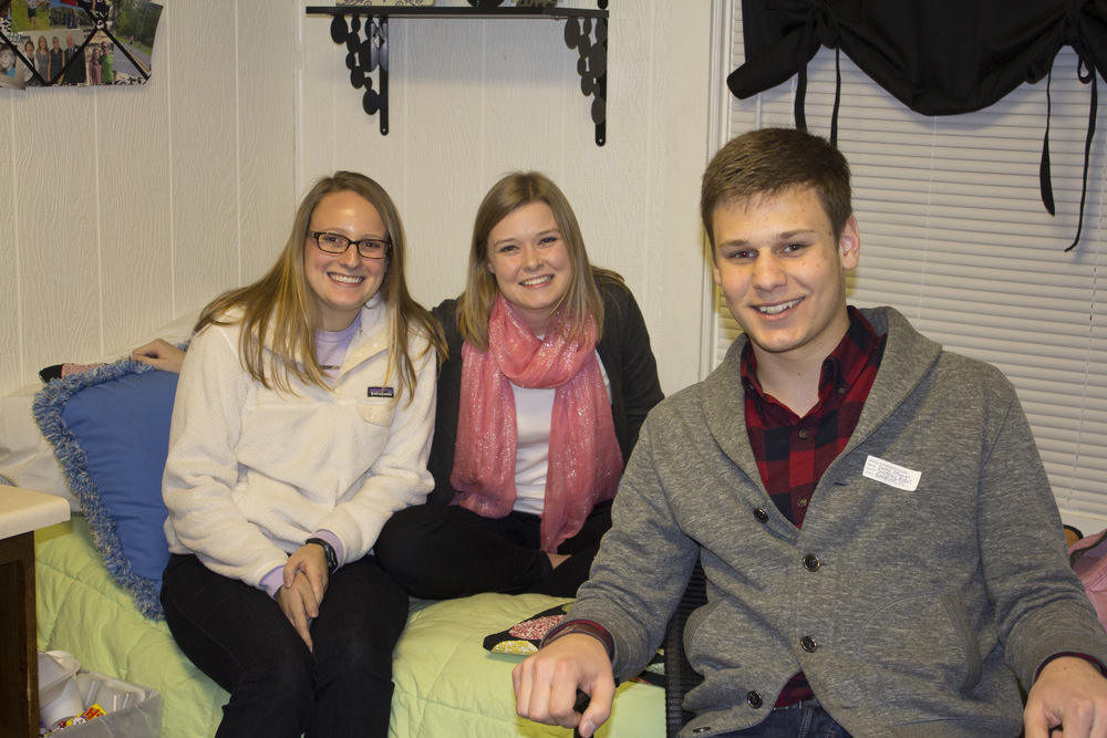 Derek Gahman, Courtney Arndt and Sally Earle drop the work and laughter for a quick picture during open dorms.