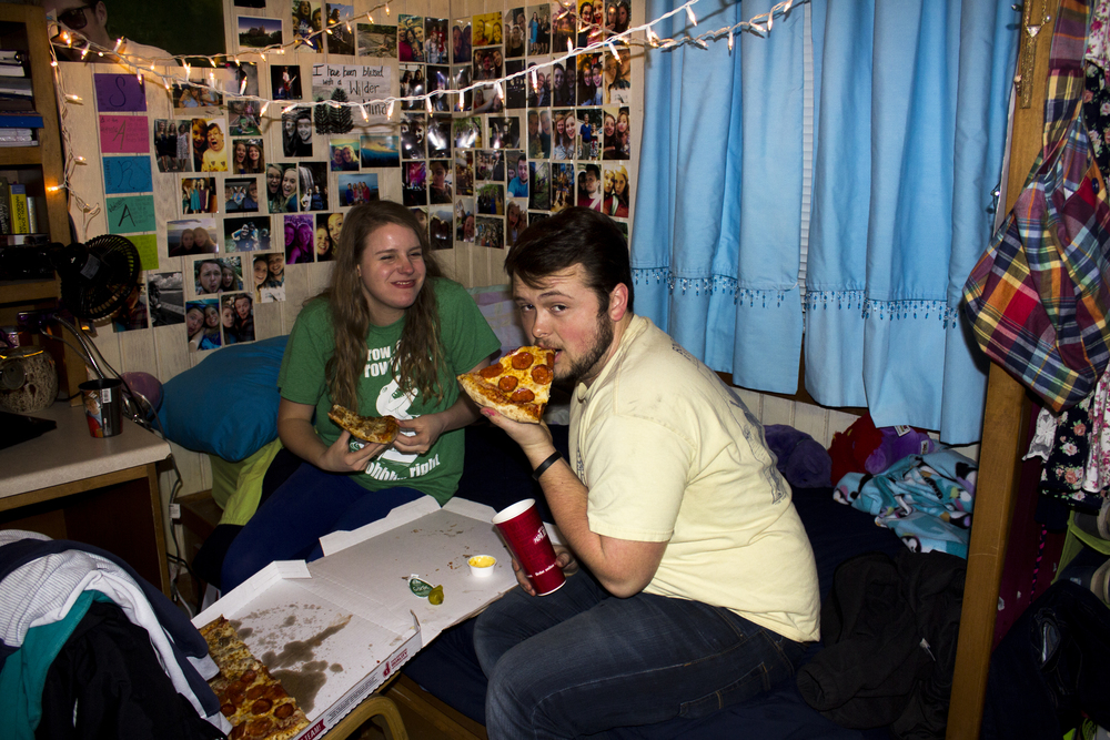 Sarah Wells and Aaron Crowell enjoy the chance to catch a pizza date during open dorms.