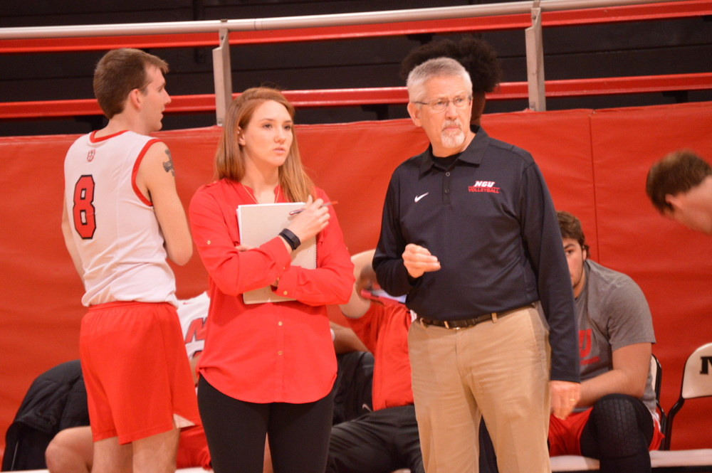 Head coach  Fred Battenfield  and assistant coach  Amber Schinzing  discuss how the game is unfolding.