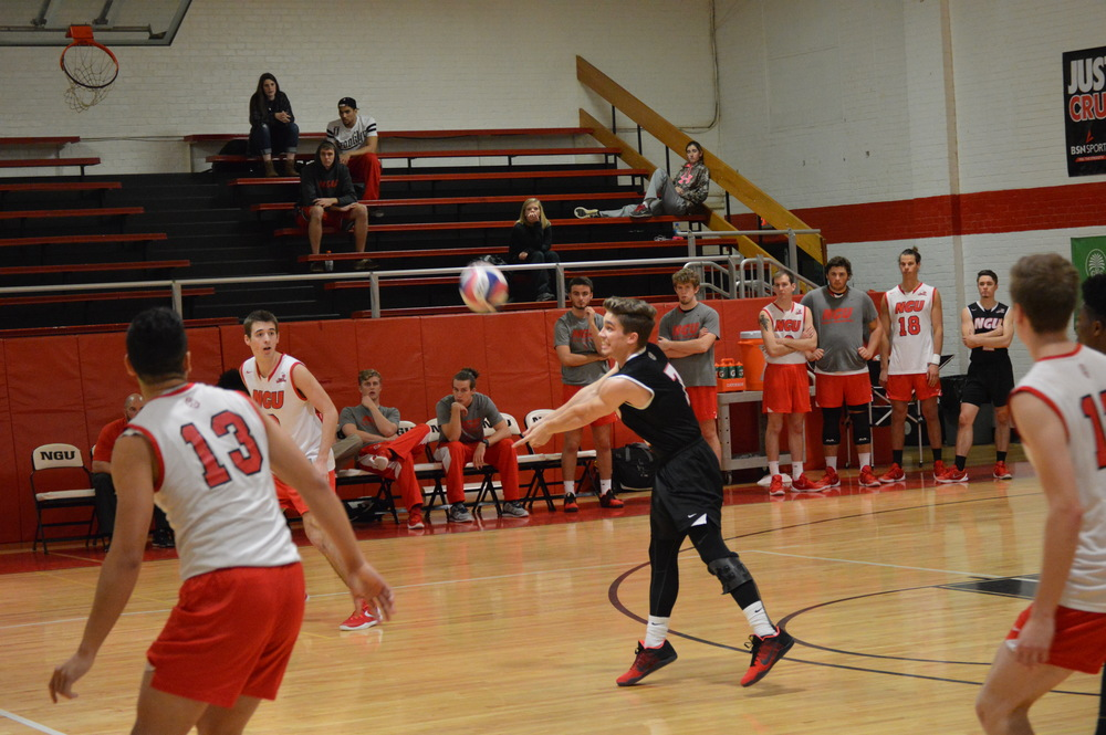 Silas Jenkins  keeps the ball up to continue the set.