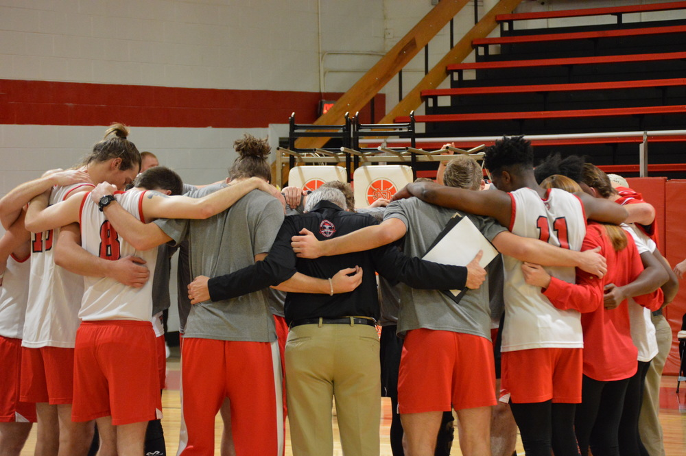 The team, along with the coaches, say a prayer after the game is over.