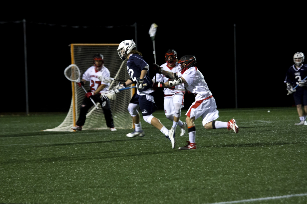 Goalie Matthew Sandoval gets ready to protect the goal from the opponent's shot attempt.