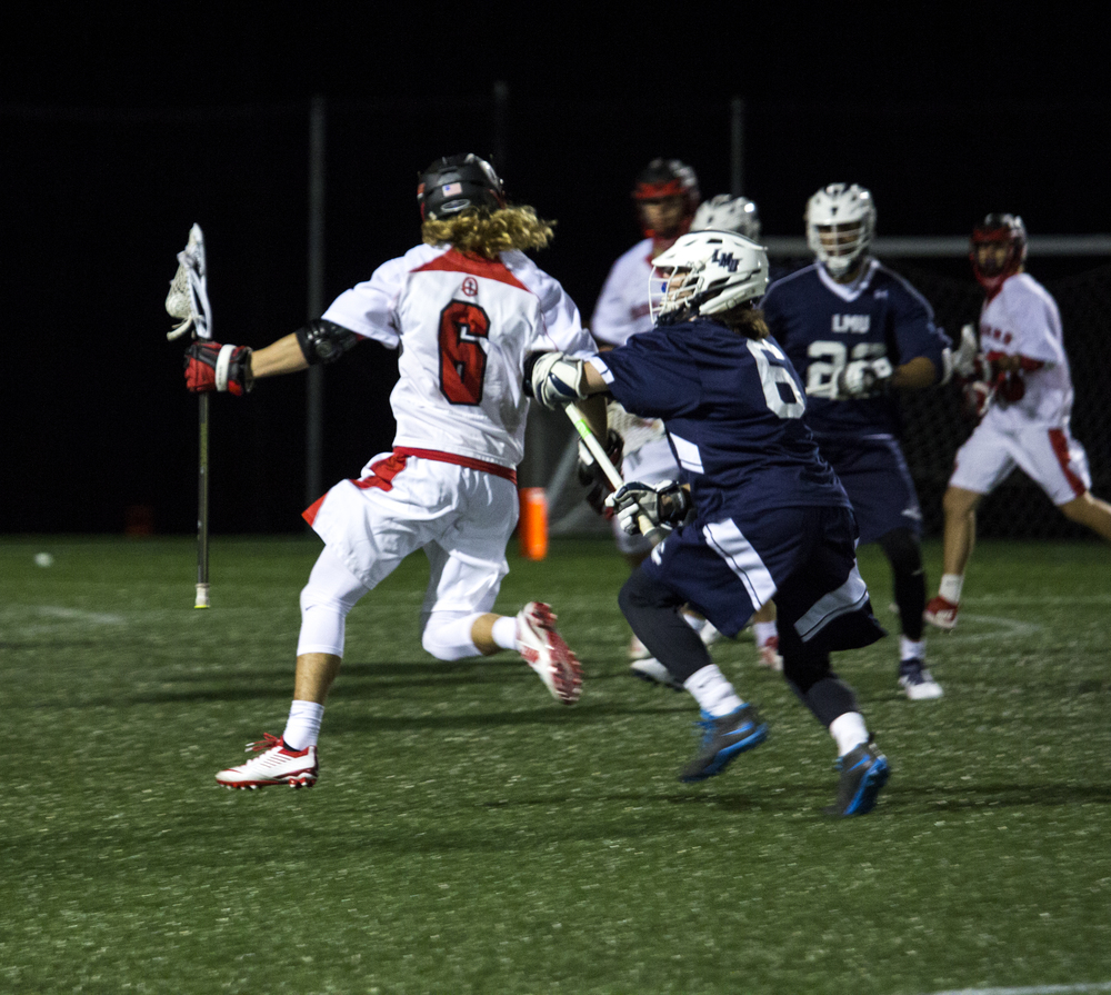 Proly fights off the opponent while keeping the ball protected.