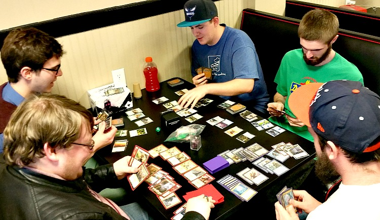 Brian Cordle (top-right) and the Gamers of the Round Table's officers, Samuel Maycock (top-left), Mitchell McDaniel, (bottom-left), Michael Miller (middle-right) and Robzy Bolin (bottom-right) playing Magic the Gathering.  Photo courtesy of Shelby Snigar.