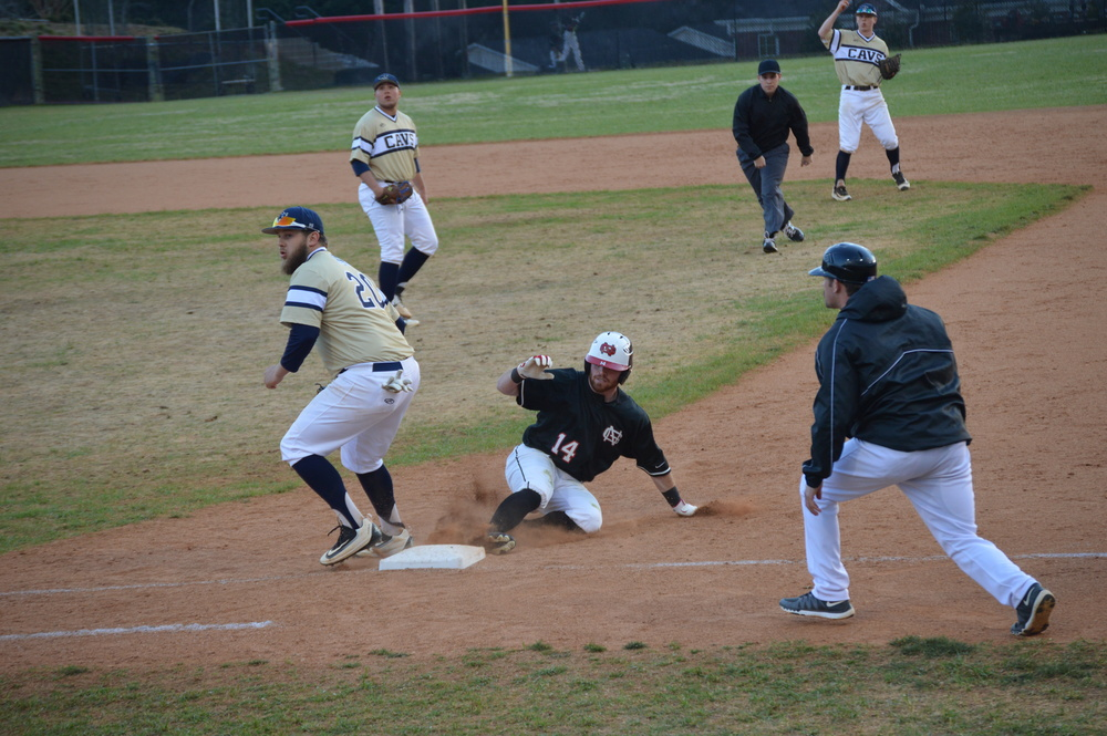 Mitchell Painter slides back to first base.