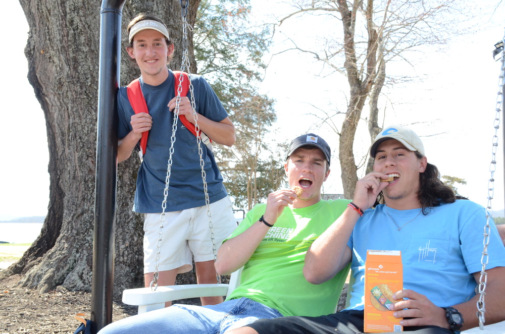 Andrew Woods, Kyle Henry and Tucker Barnes spend time swinging and eating tasty cookies on a warm day.