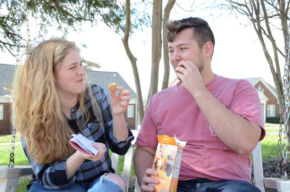 Helen Martin and Zach Grey have fun while eating Do-Si-Dos.