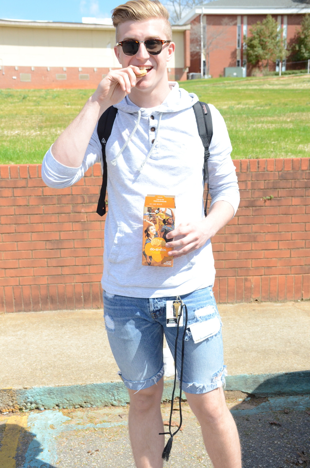 Andrew Sorton includes his Girl Scout cookies with his stylish outfit.