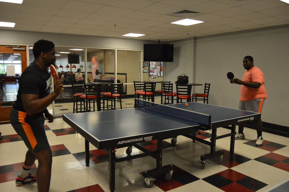 Dominique Richardson and Shamark Anderson face off in an intense match of ping pong.
